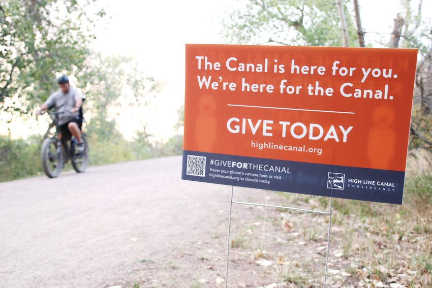 A sign asking for donations to the High Line Canal Conservancy, which put on a 71-day challenge starting Aug. 1 to get active along the canal while raising funds to plant trees and enhance the canal. The canal is 71 miles long and runs through several Denver-area municipalities.