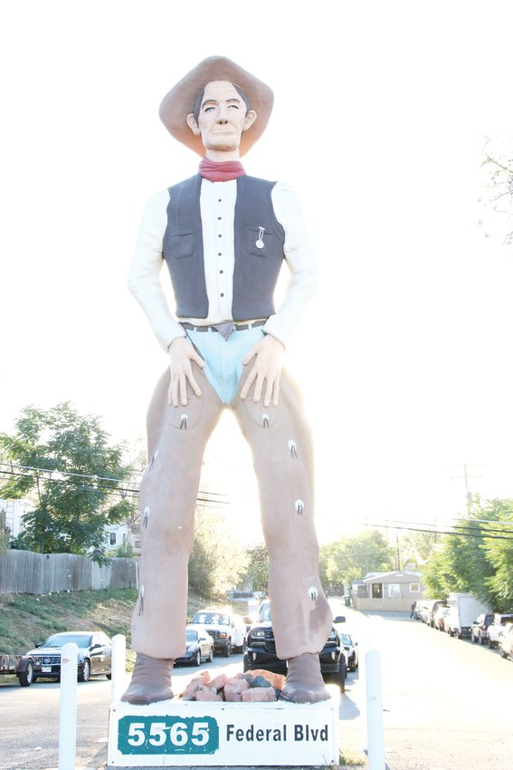The 30-foot cowboy statue at the entrance to Rustic Ranch Mobile Home and RV Park on North Federal Boulevard Sept. 12. The cowboy was originally intended as part of an amusement park that never materialized, according to an old news article clipping that the park manager has held onto.