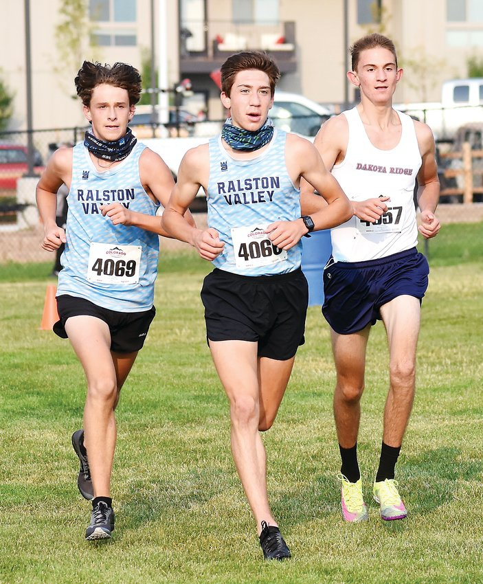 Ralston Valley seniors James Ramey (4069) and Ethan Groinic (4066) are grouped with Dakota Ridge senior Ethan Straub during the boys race of the Durden Invitational in Arvada. The Ralston Valley boys won the team title with Ramey placing second and Groinic fifth.