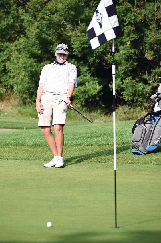 Arvada West senior Tyler Tyson uses some body language on a putt on his front-nine Sept. 14 at West Woods Golf Club.  Tyson finished third in the Class 5A Jeffco League individual standings this fall season.