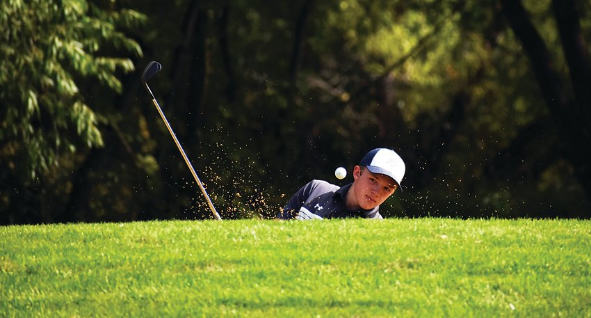 Columbine senior Drex Duffy blasts his way out of a bunker during the final Jeffco League boys golf tournament of the season Sept. 14 at West Woods Golf Club in Arvada. Duffy finished sixth in the Class 5A Jeffco individual standings this fall season.