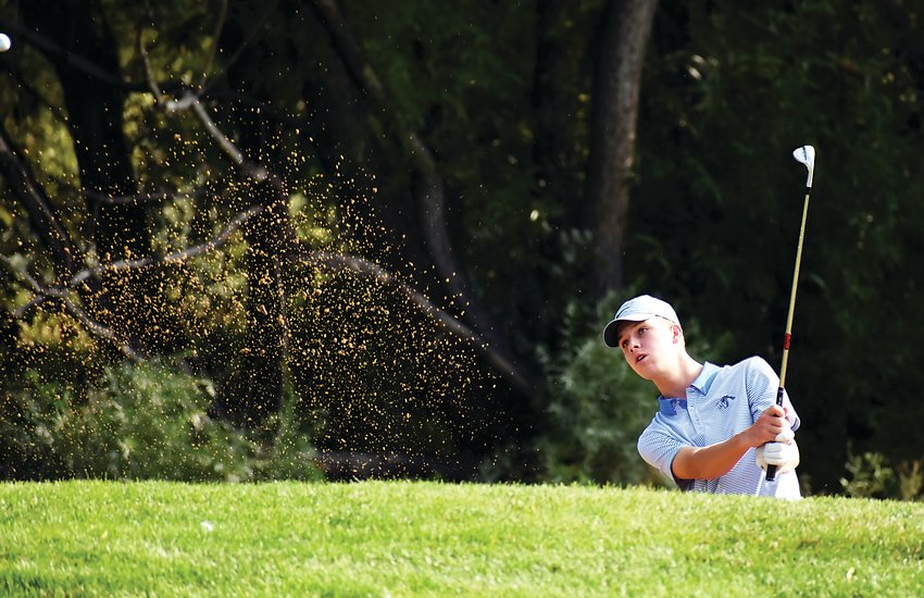 Ralston Valley junior Gage Messingham hits out of the sand during his round of 68 at West Woods Golf Club in Arvada on Sept. 14. Messingham edged Lakewood senior Ryan Liao for the Class 5A Jeffco League individual medalist this fall season.