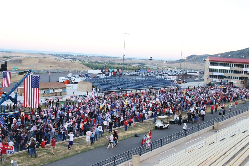 "Attendees gathered on the racetrack to take a group photo at the end of the ""Stop the COVID Chaos"" rally at Bandimere Speedway on Sept. 1."
