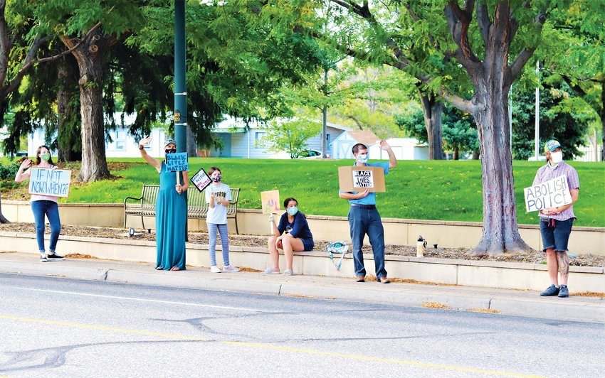 Members of Arvadans for Social Justice protest racism and police violence on Ralston Road outside Arvada City Hall on Sept. 21.