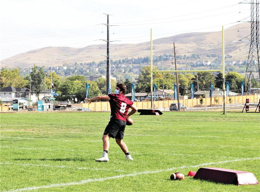 Junior wide receiver and linebacker Eddie O'Sullivan throws a pass during practice at Bell Middle School on Sept. 25.