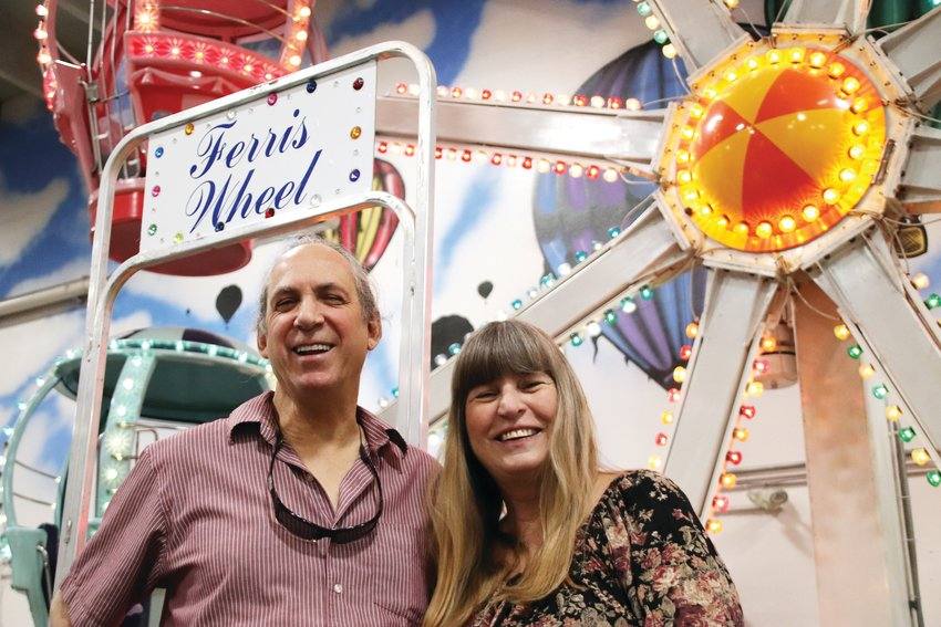 Nathan and Louise Elinoff, owners of amusement park and children's entertainment establishments for more than 38 years, stand by the ferris wheel Oct. 1 at Lollipop Park, an indoor amusement park in the central Centennial area that announced its permanent closure in late September.