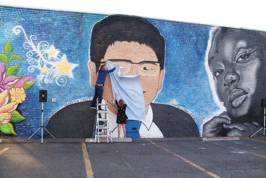 Artists Adam Clark, left, and Ksenia Poteraj unveil their mural of Kendrick Castillo, the 18-year-old STEM School student who was killed in a May 7 shooting at the school.