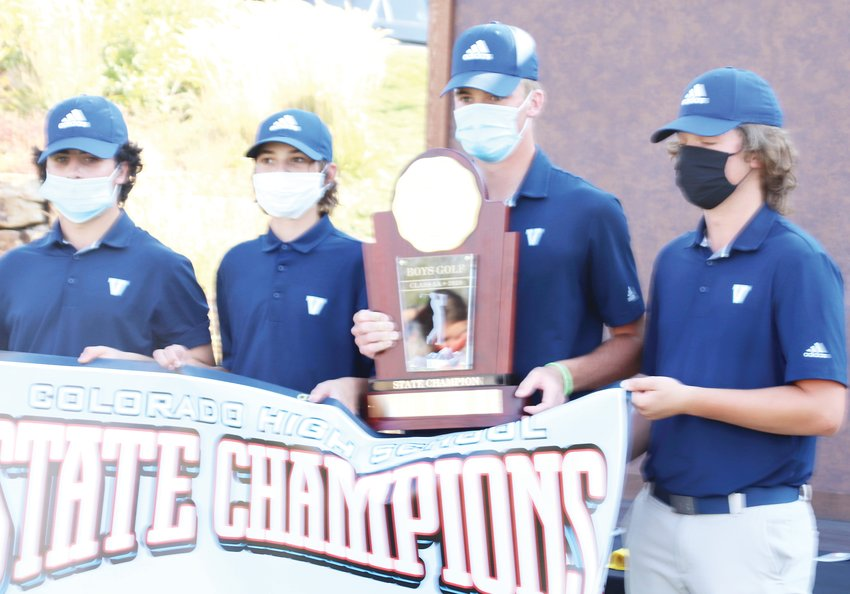 State champion Lucas Schultze of Valor Christian, holding the trophy, eagled the 18th hole which clinched the state title for the Eagles and gave Schultze the individual title.