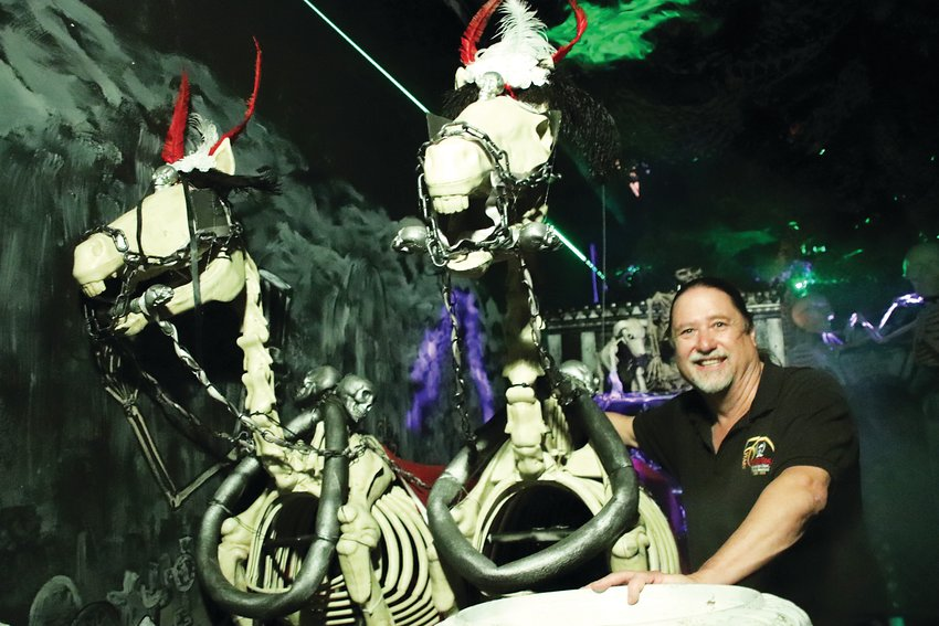 Greg Reinke, owner of the Reinke Bros. costume and magic emporium, hangs out with a couple of undead horses pulling a spooky carriage in the Haunted Mansion, one of just a few haunted houses operating in the Denver area this year.