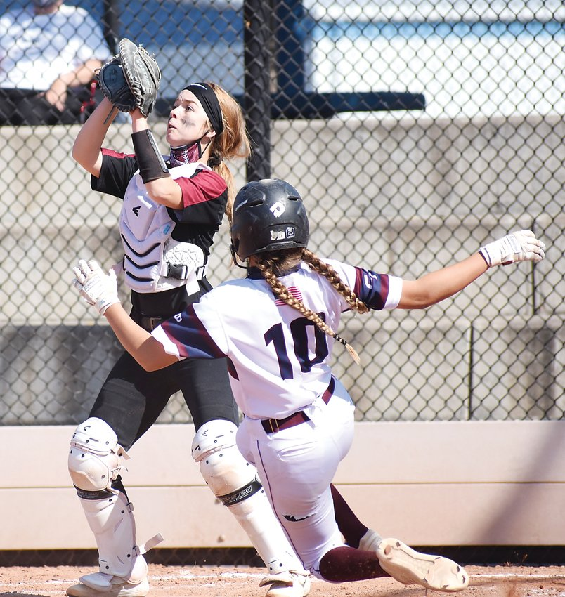 Chatfield catcher Kailey Horton goes up to grab the ball as Cherokee Trail freshman Addison Krei slides into home plate during the Cougars' 4-run top of the sixth inning Oct. 10 at Aurora Sports Park. Chatfield lost the Class 5A state semifinal game 5-1 to end the season for the 5A Jeffco League champions.