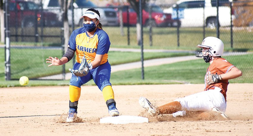 Wheat Ridge junior Aaliyah Arellano, left, waits for the ball to get to her as Mead sophomore Izzy Campbell slides into second base during the Class 4A state semifinal game Oct. 10 at Aurora Sports Park. The Farmers had their season come to an end with a 15-9 loss.