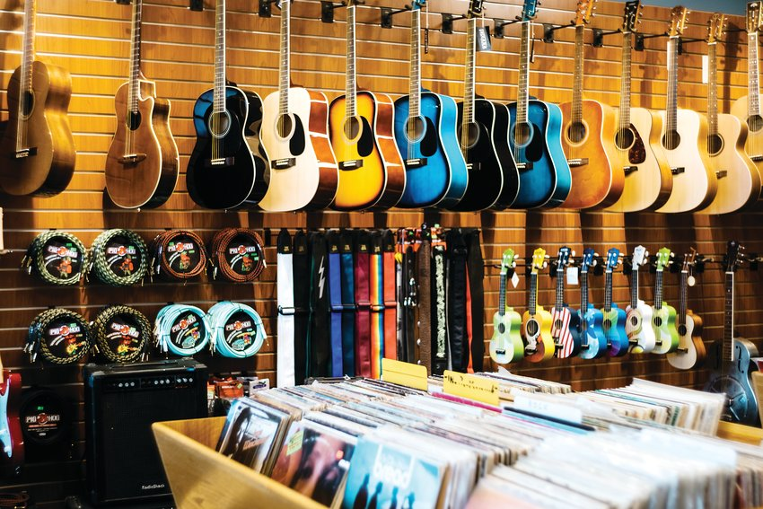 Guitars hang on a wall at Spaceman Guitars.