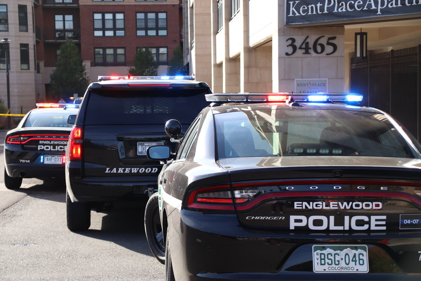 Many Englewood and Lakewood police cars parked along the perimeter of the Kent Place apartments, where a car chase ended before police arrested two people.