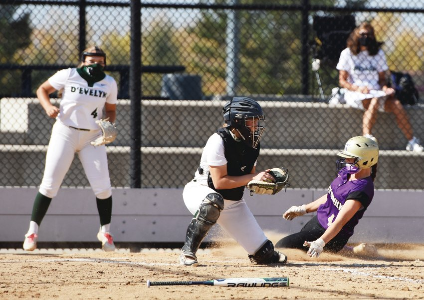 Holy Family's Ava Kuszak slides home safely with a run against D'Evelyn, during the CHSAA 4A Softball Semifinal game Oct. 10 at Aurora Sports Park. The Tigers overcame a 6-1 deficit, to rally past the Jaguars, 12-7.