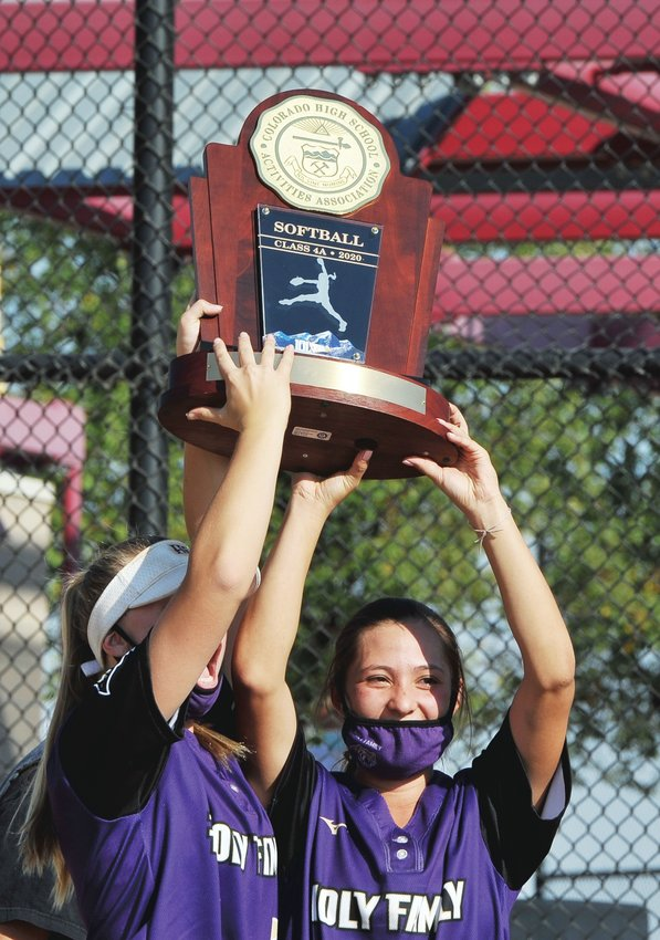 Holy Family starting pitchers Cassidy Chvatal, left, and Jaelen Giron, are first to hoist the CHSAA 4A Championship trophy.