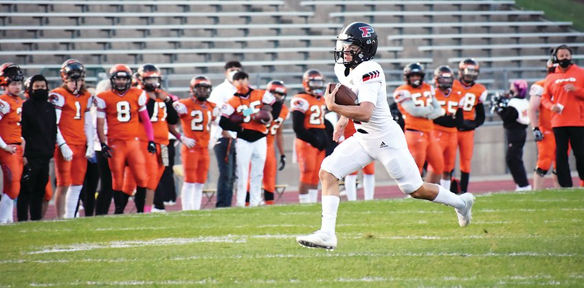 Pomona senior Jack Pospisil breaks free for a 50-yard touchdown run in the opening minutes Oct. 15 against Lakewood at Jeffco Stadium. The receiver turned quarterback this season for the Panthers had a pair of touchdown runs in Pomona's 42-0 victory over the Tigers.