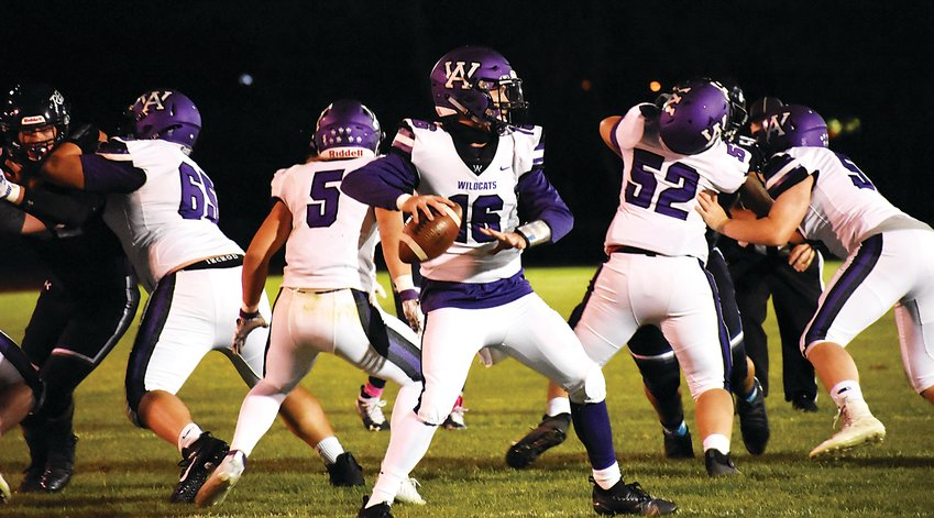 Arvada West senior quarterback Evan Hurlburt (16) gets some protection from his offensive line before getting off a pass against Columbine on Oct. 16 at Jeffco Stadium. The Wildcats suffered a 34-10 loss to even up A-West's record to 1-1 on the season.