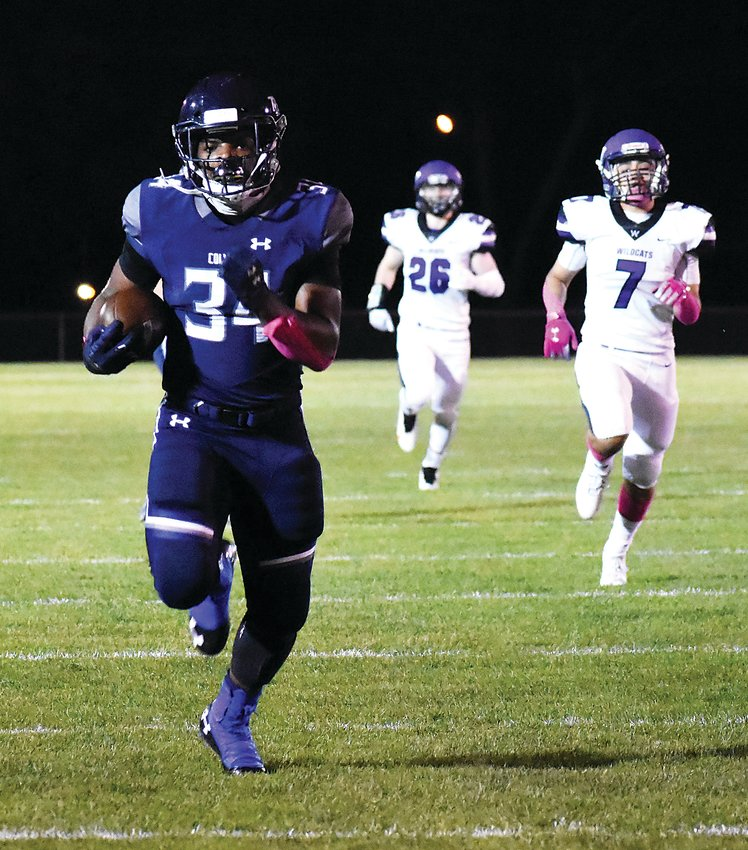 Columbine junior Seth Cromwell (34) breaks free for a 73-yard touchdown run in the first quarter Oct. 16 at Jeffco Stadium. Cromell already has 272 yards rushing and five touchdowns on the ground for the Rebels through two games this season.