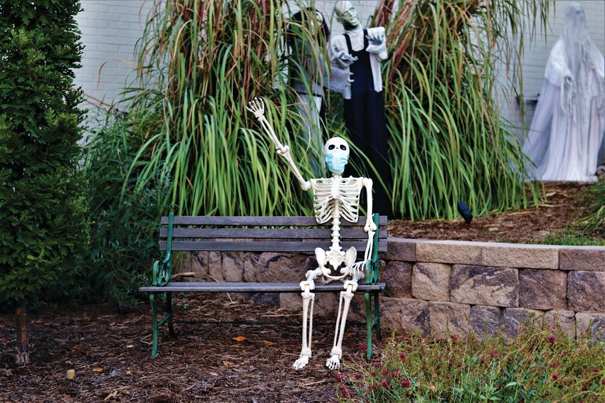 A masked skeleton sits outside a home in Centennial.