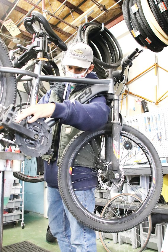 Fernando Ibarra works on a bike at Lucky Bikes Re-Cyclery. Ibarra said working at the shop has given him skills, friendships and life experience.