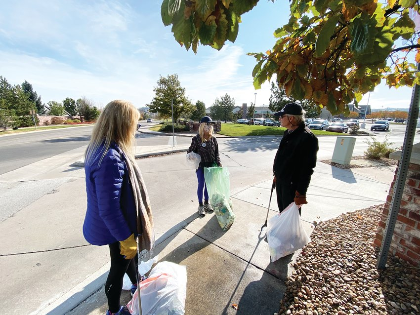 From left, Carol Sorensen, Kathy Reiner and Steve Sorensen of the Lone Tree Sustainability Team, take a break from cleaning up trash around the shopping complex at Yosemite Street and Lincoln Avenue to talk about their favorite subject: saving the earth. The team organized a trash clean up Oct. 24 to keep people thinking about the larger goal of making their city more sustainable.