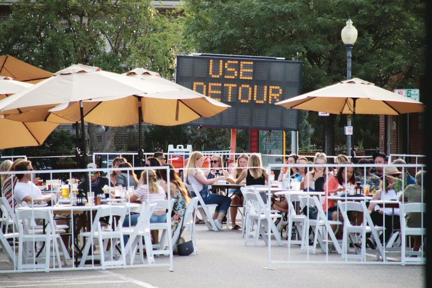 Diners eat and drink at the west end of Littleton's Main Street in July. Offering outdoor dining is one way restaurants have responded to the COVID-19 pandemic.