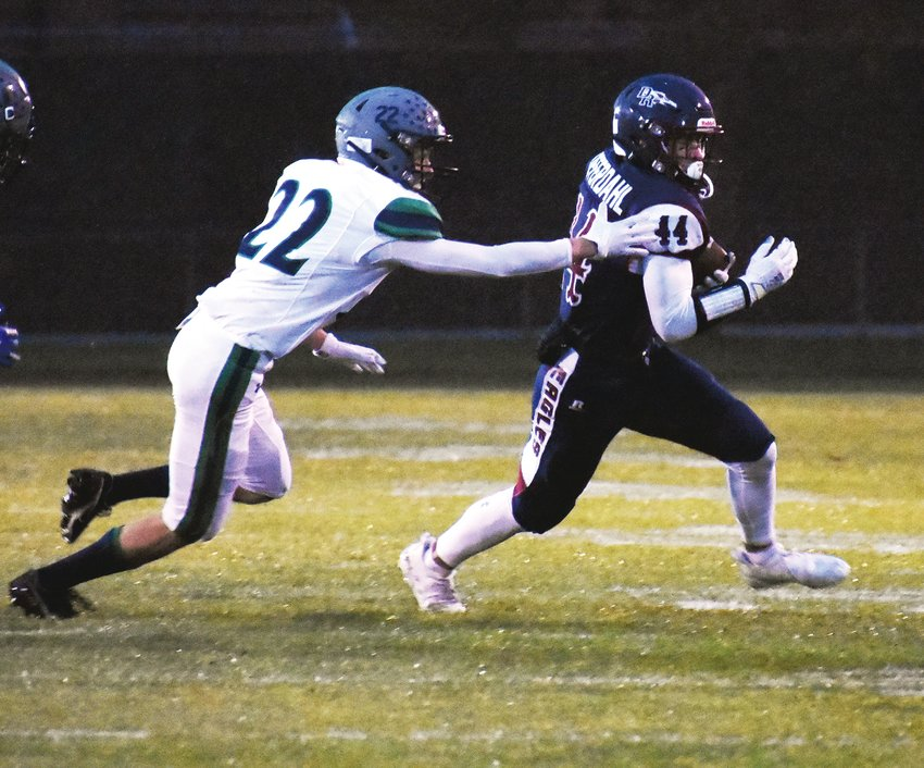 Dakota Ridge senior Charlie Offerdahl (44) attempts to break the tackle of Standley Lake sophomore Max Stout. Offerdahl had touchdown runs of 35 and 15 yards in the second quarter to extend the Eagles' lead to 35-0 at halftime. Offerdahl has already scored eight touchdowns over three games this season.