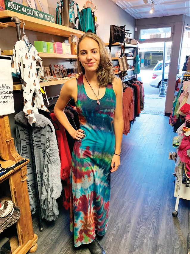 Anastasia Fidler, daughter of store owner Jody Fidler, wears a tie dye maxi dress available at Wheelhouse Gifts in Platt Park. Jody Fidler opened the gift shop's brick-and-mortar location this past summer after operating a mobile gift shop for about four years.