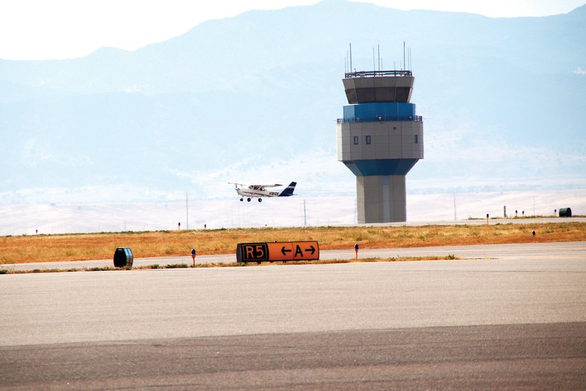 A small airplane takes off in front of the control tower at Rocky Mountain Municipal Airport Oct. 22.