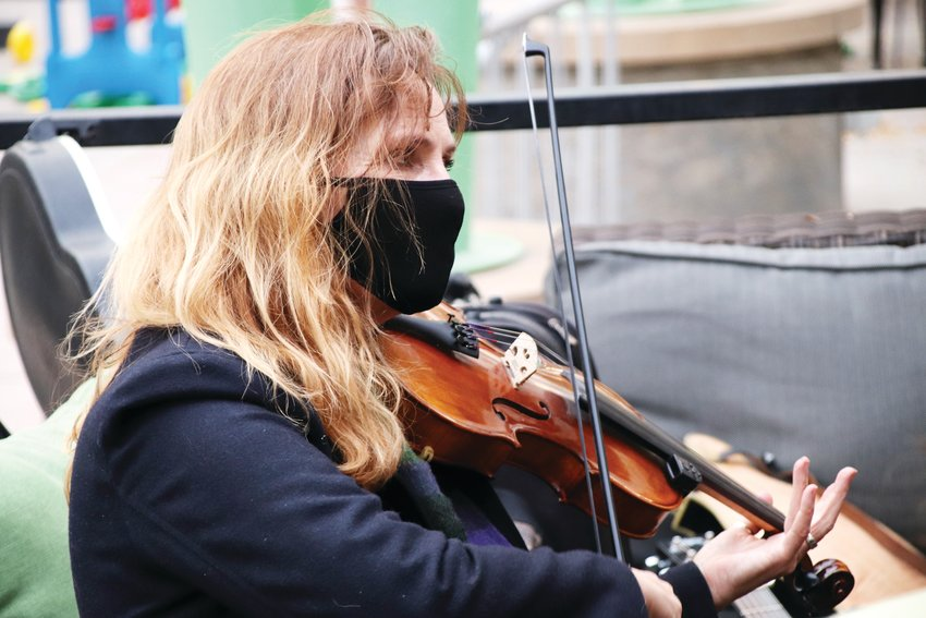 Susan Newton, 58, of the Roxborough Park area, plays fiddle in the band.