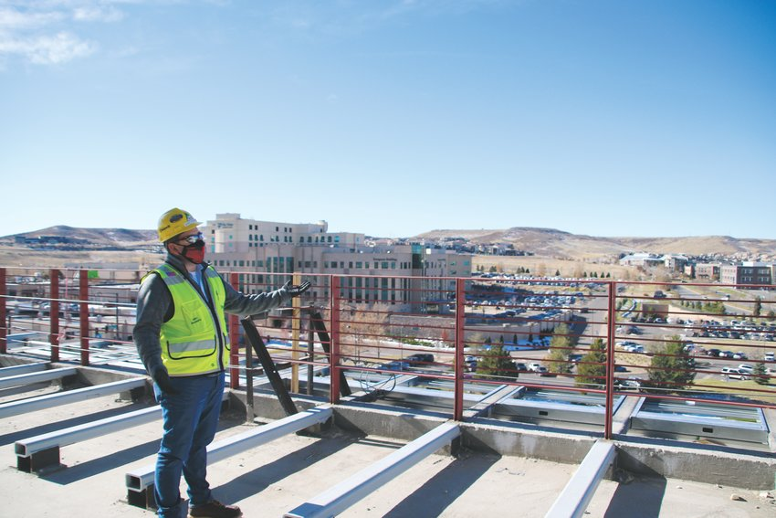 Eric Roumph, project manager for the Kiewit regional headquarters construction, gives a tour of the first of two buildings under construction west of I-25 in Lone Tree Oct. 29. The engineering firm will complete the first building, at five stories and 252,000 square-feet, by July 2021.