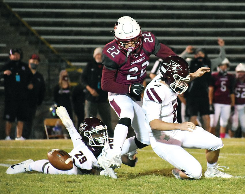 Chatfield senior Jack Gillespie (22) sacks Golden quarterback Joey Mancuso (2) and forces a fumble during the first half Oct. 30 at Jeffco Stadium. The Chargers got a bounce-back win with a 37-14 victory over the Demons.