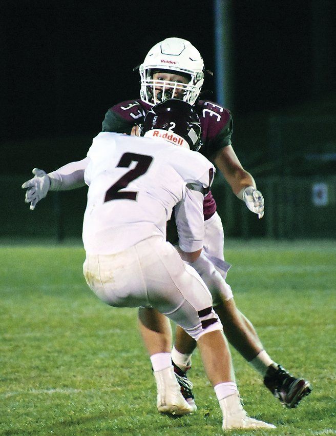 Chatfield junior Elijah Rodriguez (33) closes in for a sack of Golden quarterback Joey Mancuso during the Class 4A Jeffco League game Oct. 30. Rodriguez also had an interception he ran back for a touchdown in the Chargers' 37-14 win.