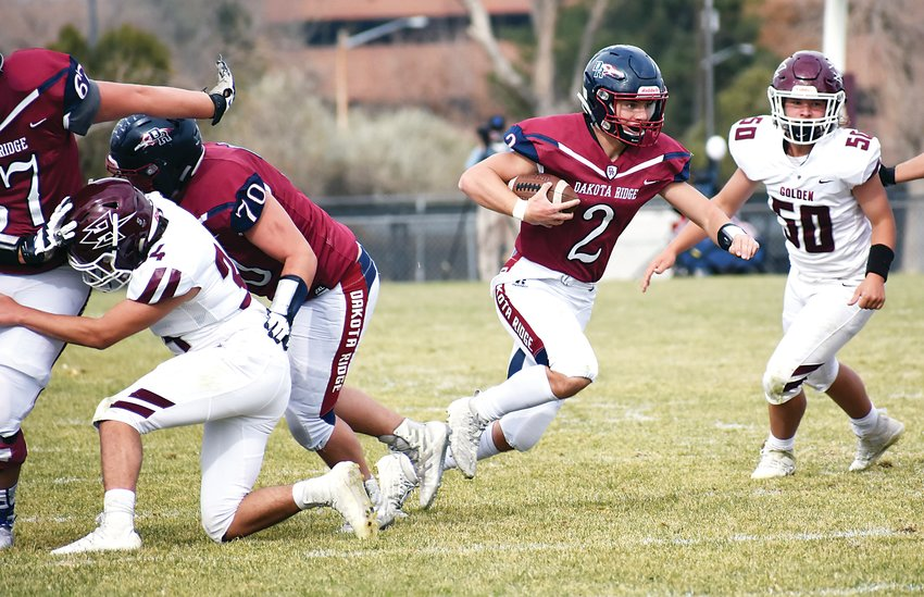 Dakota Ridge senior quarterback Ben Gultig (2) escapes out of the pocket during the Saturday afternoon game at Jeffco Stadium. Gultig tossed three touchdown passes and also had 68 yards rushing during the Eagles' 45-3 victory over Golden.