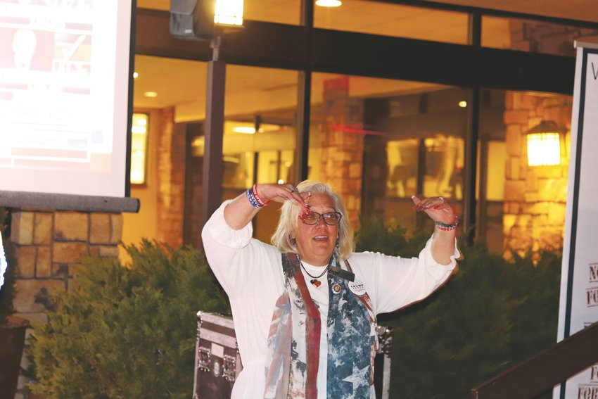 "Laurel Imer does the ""Trump YMCA"" at a party for Republican candidates held at the Denver Mariott West hotel in Golden."