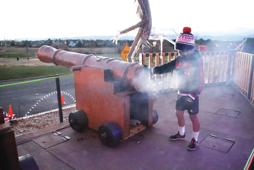 Ryder Siegel, 6, tries out a cannon on Meighan's pirate ship. The cannons release fog, play a loud sound and flash a red fog light when pressed.