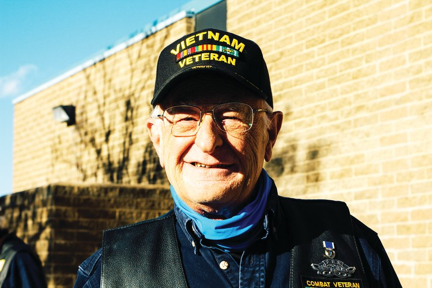 Veteran Cliff Fejfar attends a Veteran's Day ceremony at Green Mountain High School.