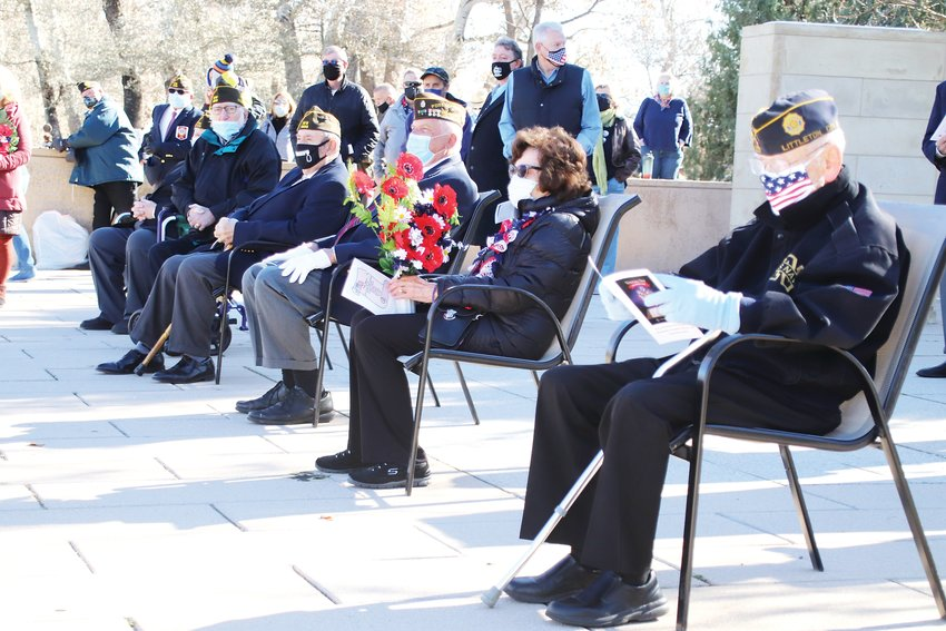 Veterans and their loved ones watch the ceremony at Ketring Park's World War II Memorial.