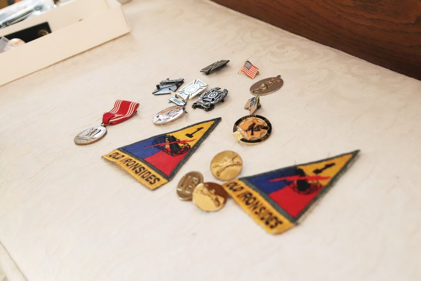 Former U.S. Army Spc. 4 Bill Colgin Sr. lays out his service awards and decorations from 1961-63. Colgin, from Casper, Wyoming, and now living in Castle Rock, served as a mortar specialist during the Cuban Missile Crisis, saying it was the proudest moment of his service.
