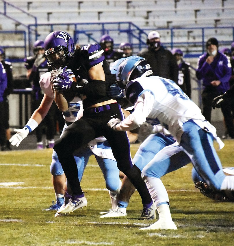 Arvada West junior Cade Russel (28) fights for yards during the Wildcats' lone scoring drive Nov. 12 against Ralston Valley.