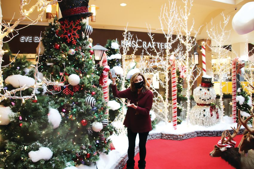 Pam Kelly, senior general manager for Park Meadows, shows off the new touchless Santa display Nov. 13. The display allows for families to take photos with Santa and kids can have some one-on-one time with the big man.