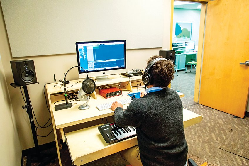 Sivan Johnson, a creative specialist at Arapahoe Libraries, works in the Southglenn Library recording studio in the days before the COVID-19 pandemic.