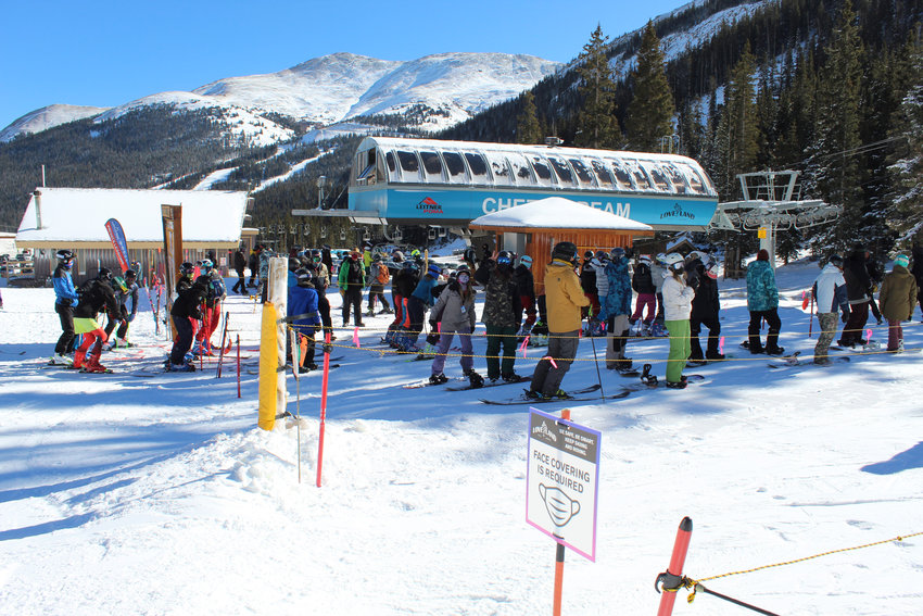 Skiers and snowboarders are instructed to wear a face covering while standing in the lift line during Opening Day on Nov. 11.