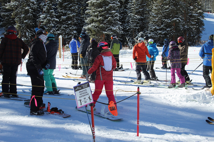 Skiers and snowboarders are cautioned to keep their space while waiting in line for Chet's Dream..
