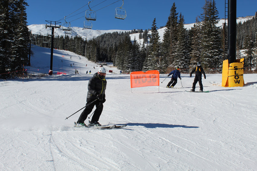 Skiers and snowboarders descend the mountain at Loveland Ski Area on Opening Day, Nov. 11.