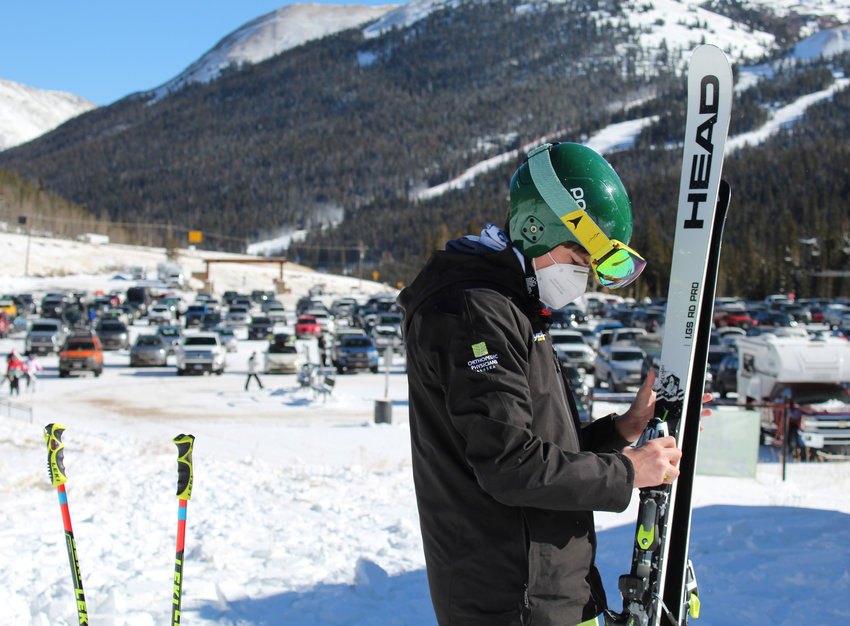 Jack Wrigley, 15, inspects his skis as he waits at Loveland Basin during Opening Day on Nov. 11.