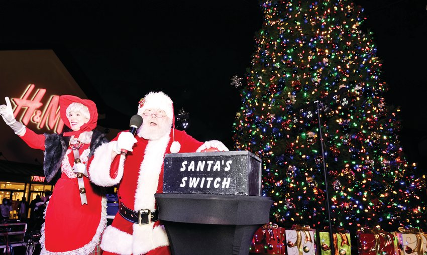 Santa flips the switch to light up the Outlets at Castle Rock Christmas Tree.