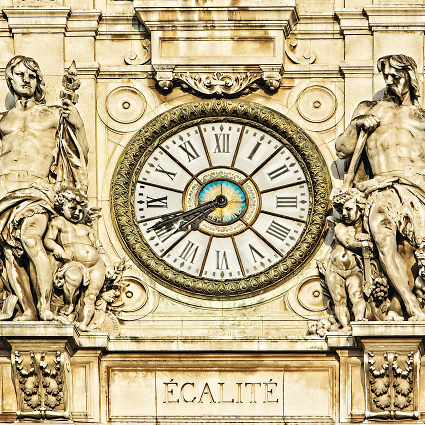 """Egalite"" photograph by Loren Gilbert is included in the ""It's a Small World"" exhibit at Town Hall Arts Center. It's a clock set in a historic stone building."
