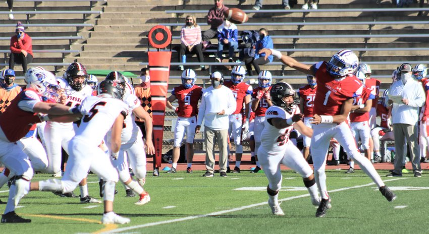 Pomona's defense applies pressure on Cherry Creek quarterback Julian Hammond during the first quarter Saturday at Stutler Bowl. (Michael Hicks)