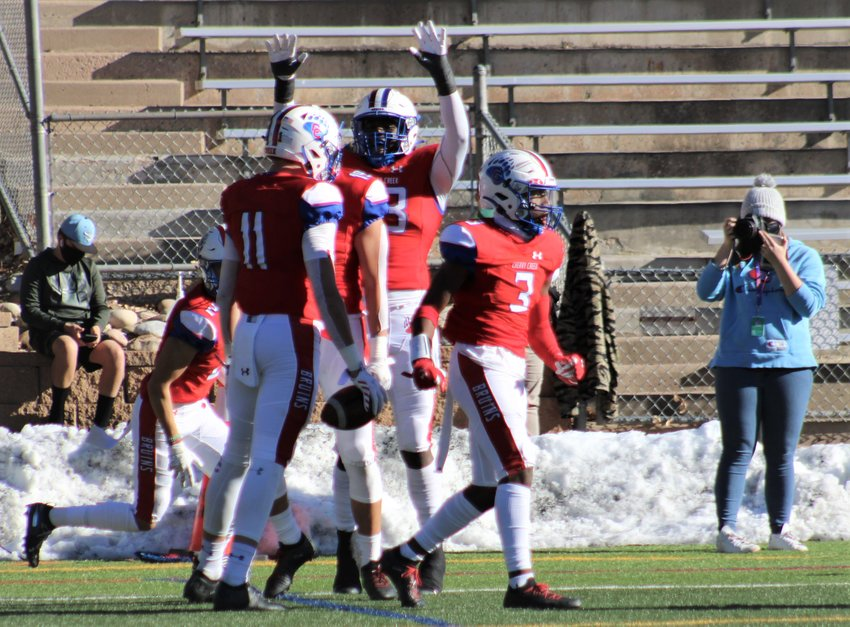 Cherry Creek players celebrate Gunnar Helm's first-quarter TD against Pomona on Saturday at Stutler Bowl in Greenwood Village. (Michael Hicks)